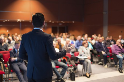 Speaker at Business Conference and Presentation. Audience at the conference hall.